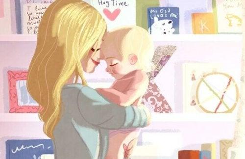 Une maman en train de faire des câlins à son bébé