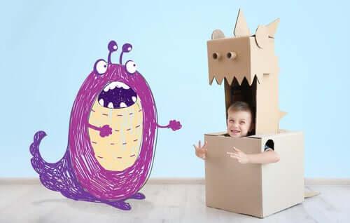 Un monstre et un enfant dans un carton