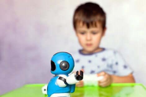 Un enfant qui joue avec un robot.